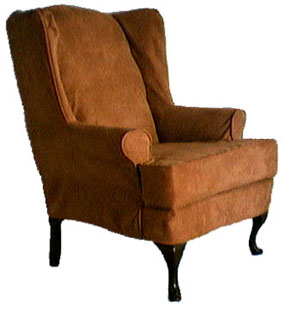Wingback chair slipcover with short skirt